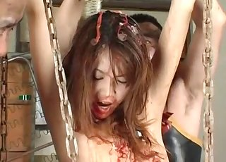 Asian slut is not afraid to use fish entrails for her pleasure