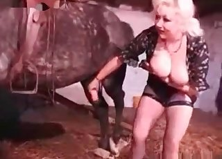 Girl with fishnets is alone with a stallion and she likes him