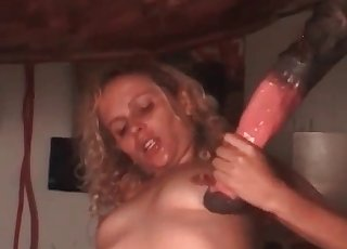 This incredible blonde slut is giving a BJ to a stallion