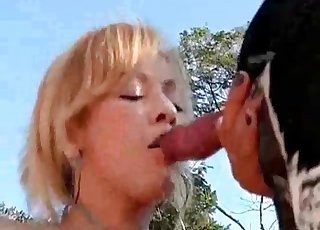 Animal's cock devoured by her mouth