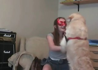 Masked musician and her trained dog
